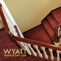 sweeping staircase, elegant banister, stair details, basement stairs, light-filled stairwell