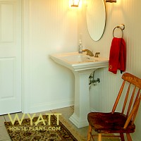 classy powder room, elegant bathroom, simple powder room ideas, top shelf, pedestal sink, bead board, display shelf